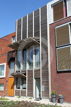 Modern Dutch home with wooden shutters