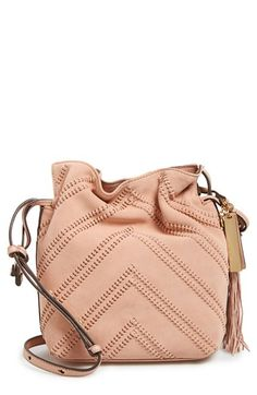 Free shipping and returns on Vince Camuto 'Nella' Crossbody Bag at Nordstrom.com. The bucket-bag silhouette goes slim and trim on this compact crossbody featuring stylish woven, chevroned detailing on suede. The look features a pebbled leather back for ease of everyday wear, as well as an adjustable crossbody strap and just-right interior. A logo-etched charm and swingy tassel complete the trend-right bag.