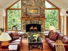 """42 Lovely Scandinavian Fireplace To Rock This Year. A stone fireplace design your pioneer ancestors would envy is the """"Multifunctional Fireplace."""" The hearth. Fireplace Between Windows, Scandinavian Fireplace, Scandinavian Living, Stone Fireplace Designs, Stone Fireplaces, Room Additions, Family Room Design, Family Rooms, Living Room Remodel"""