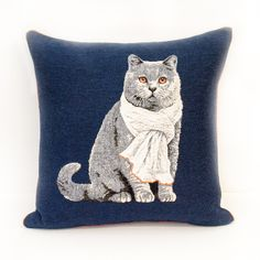 Embroidered Cat Cushion: Tobias sits proudly front and centre wearing his favourite scarf on this beautiful embroidered cushion. The royal blue backdrop with contrasting orange piping give this contemporary design the wow factor.