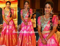 Bride Laya looked gorgeous in a traditional lehenga at her wedding reception. She wore a pink heavy border kanjeevaram lehenga that featured gold and silver zari animal motifs all over paired with blue checkered silk dupatta a Lehenga Saree Design, Half Saree Lehenga, Kids Lehenga, Lehenga Designs, Saree Dress, Saree Blouse Designs, Dress Designs, South Indian Bride, Indian Bridal