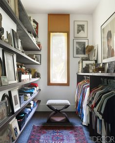 Photographs by Monte Coleman, José Picayo, and Jaimal Odedra line the walls of the walk-in closet; the stool is by Carol Egan, and Benoist Drut found the Oriental rug at a local yard sale.
