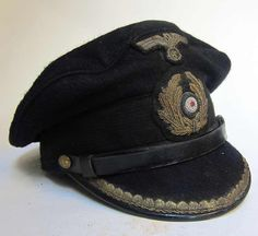 Reproduction German U-Boat Submarine Blue Topped Peaked cap with ageing and numerous dark & worn and tarnished areas as worn by an officer in the U-boat arm. Lovely 'crusher' shape. www.warhats.com