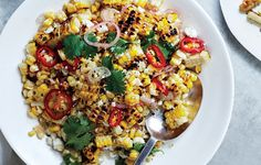 Charred and Raw Corn with Chile and Cheese Recipe - Bon Appétit. Had with the steak tacos and it was amazing!