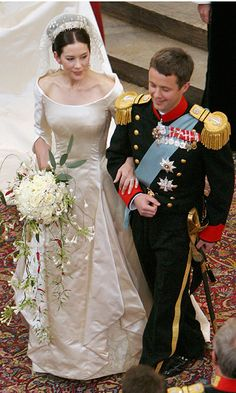 Frederik was a true Prince Charming in his military uniform, while his bride was romantic in her off the shoulder gown as she carried a cascading bouquet that featured roses and Australian eucalyptus flown in especially for the occasion. Photo: Getty Images