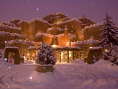 Snow Topped Inn Is Decorated for the Winter Holidays in Santa Fe Photographic Print by Ralph Lee Hopkins at Art.com