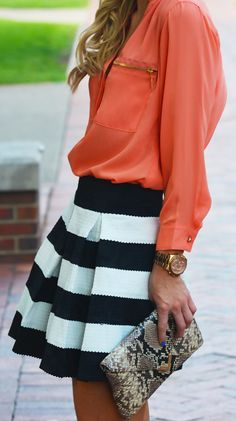 Coral top with striped pleated skirt