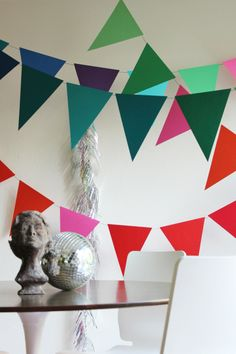 How To Make Giant Bunting tutorial - make double-sided bunting by using your Xyron Tape Runner and adhering the triangles back to back!