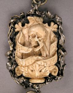 Rosary Date: ca. 1500–1525 Culture: German Medium: Ivory, silver, and partially gilded mounts. The end beads are interesting in that they are half skull and half fully fleshed heads.