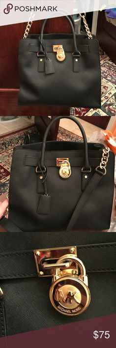 Michael Kors Lock Handbag/Tote Slightly used Michael Kors bag. You can wear it with the long strap or by the handle ears. Key to open lock comes with purse. No stains/smell inside. Looks brand new. Price firm and set to sell. Ask for free shipping. 100% authentic. MICHAEL Michael Kors Bags Shoulder Bags