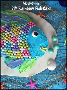 What a great cake for schools or a little fish party. Rainbow Fish cake would be great for a Kindergarten class.