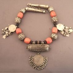 Silver, coral, old silver coins , amulet,Yemen Description Great piece for collectors with its silver work ,the old arabic coins and the coral beads...