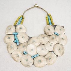 Old Tibetan Naga breastplate | Shell, Leather, Yellow and blue glass beads