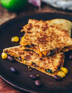 These easy Vegan Sweet Potato Quesadillas loaded with blacks bean corn and dairy-free cheese make the perfect quick meal or snack. Theyre gluten-free healthy flavorful cheesy and very simple to make. Quesadilla Vegan, Sweet Potato Quesadilla, Quesadillas, Mexican Food Recipes, Vegetarian Recipes, Sweet Recipes, Mcdougall Recipes, Baked Avocado, Dairy Free Cheese