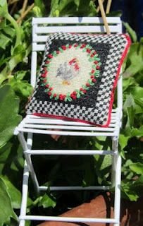 Folding chair & needlepoint pillow