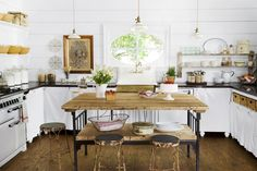 Because of the white walls and touches in this Texas kitchen, the room doesn't look cluttered. It's every country woman's dream.