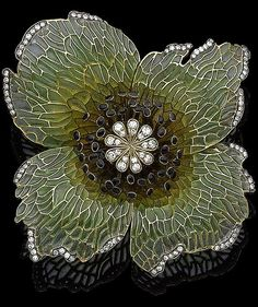 A plique-à-jour enamel and diamond-set flower brooch, by Moira The large flowerhead, centrally-set with a single-cut diamond stamen, accented with black enamel pistils, within a yellow to green plique-à-jour enamel petal surround, with similarly-cut diamond highlights, diamonds approx. 0.85ct total, signed Moira, numbered, detachable brooch fitting, width 6.3cm, maker's case