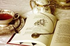 book and tea - and the book appears to be Through the Looking Glass by Lewis Carrol so double awesome :)