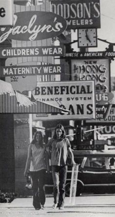 Two students walking along Main Street in Moscow, Idaho in 1972. From the 1972 Gem of the Mountains Digital Yearbook #vintage