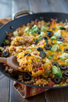Mexican Rice Skillet - This Mexican rice skillet is a one pot meal you'll make again and again. Especially because you can make it in under 30 minutes!