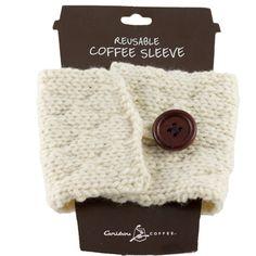 Omdat die bekers altijd te warm zijn.Reusable cream colored knit coffee sleeve with wooden button.