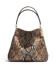 This graceful and compact design is updated in elegantly textured fabric with an exotic python print.
