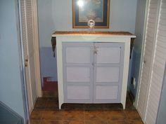 repainted antique replica cupboard