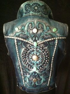 Hand painted denim vest size medium. Features a studded look and Swarovski stones. Painted is turquoise, silver and a hint if black! $150.00