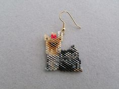 Arent these adorable Yorkshire Terrier earrings just too cute? They measure approximately 1-1/8 wide and 1-1/4 long and are made from approximately 544 tiny seed beads intricately woven, one at a time, with a needle and thread to create the finished earrings you see here. The pierced fish-hook ear wires are gold-plate over surgical steel. If you prefer that your little Yorkies dangle from a post-type or even clip-on type, please let me know when you order so I can convert them befo...