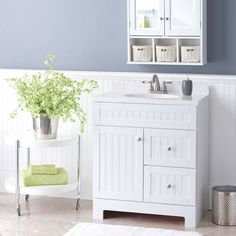 Beadboard isn't just for walls. This charming vanity with cultured marble top boasts generous storage and easy installation.
