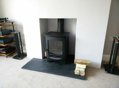 Charnwood with rear flue adapter installed onto riven slate hearth Wood Burner Fireplace, Fireplace Hearth, Fireplace Design, Fireplace Ideas, Log Burning Stoves, Wood Burning, Slate Hearth, Cosy Lounge, Chimney Breast