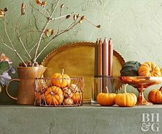 Our fall pumpkin decorating ideas will get you ready for the season. Fall pumpkin decorations, painted gourds, squash, and other ideas featuring natural elements will add autumnal elegance to your home—inside and out.