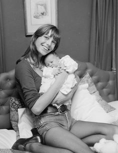 August 12, 1971  Where: With daughter Charlotte Lucy.   Photo: Leonard Burt/Central Press/Getty Images