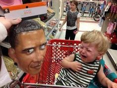 Baby scared to death by Obama mask!