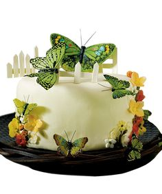"""Hand Painted Garden Green Butterfly Cake Decoration Size Approximately: 2""""-4""""W Includes 24 Butterflies The best cake decorations are dimensional items, things which seem real, solid, which jump out of the surface of the cake, creating a scene that is bursting with vibrant life. Here we see a perfect example of that in the hand painted garden green butterfly cake decorations, a collection of charming little fluttering forms that can add color and whimsy to your next culinary…"""