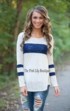 The Pink Lily Boutique - One Step Closer Oatmeal and Navy Tunic , $34.00 (http://thepinklilyboutique.com/one-step-closer-oatmeal-and-navy-tunic/)