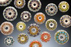 http://www.kristinalogan.com/beads/beads-add.htm#  Lampworked Glass Beads by Kristina Logan