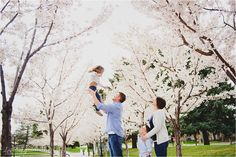Family Photo Shoot in the spring blossoms.  Lori Romney Photography