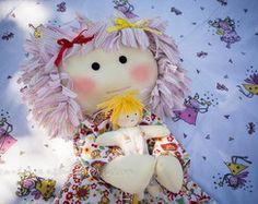 boneca de pano com bebê