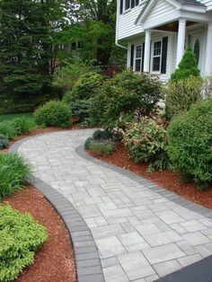 Where would your walkway lead you? This beautiful walkway was installed using Cambridge Pavingstones with