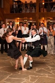 couples dance in kilts