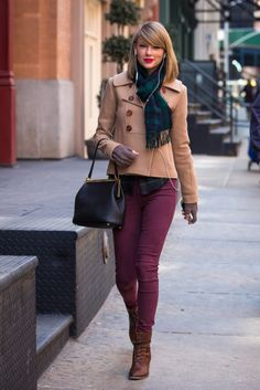 Short double-breasted coat with green plaid scarf and burgundy jeans out in New York