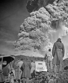 "Troops watch the eruption of Mt. Vesuvius, Italy, 1944. In ""On Distant Shores,"" flight nurse Lt. Georgie Taylor witnesses this eruption."