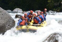 Raft full of adventure seekers navigating the Tongariro River. Image courtesy of Tongariro River Rafting.
