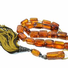 "Introducing our new category ""Collectibles"" with an old Natural Baltic Amber Komboloi (worry beads). Transparent cognac color, clearly displays Fossil inclusions in beads. A great addition to a collection. A special gift with value, style and character!"