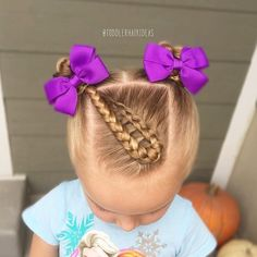 Today I did a center folded-back dutch braid on a diagonal into braided piggy buns. It's a funky look but Viv LOVES it! Toddler hair ideas