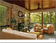 Covered outdoor patio with fireplace-I'd love to have a fireplace in our porch one day!