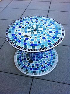 Mosaic garden table made from wooden cable spool