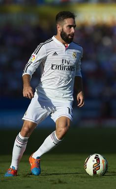 Daniel Carvajal of Real Madrid runs with the ball during the La Liga match between Levante UD and Real Madrid at Ciutat de Valencia on October 18, 2014 in Valencia, Spain.