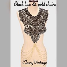 Black lace and gold chain statement necklace! Crocheted black top front and over shoulders. Attaches in back. Hot draping goldtone chains. Boutique Jewelry Necklaces